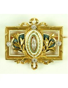 Lucien Gautrait 1890-1900 'Belle Époque' Brooch: diamond/ enamel. Of ribbons, foliate, garland design, centering a marquise-cut diamond against white & blue guilloché enamel cartouche: w/French assay mark & marker's mark for Léon Gariod. The brooch signed 'L Gautrait', numbered