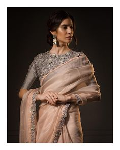 This gorgeous pastel peach organza saree paired with a grey floral embroidered crop top is nothing but lit. Trendy Sarees, Stylish Sarees, Fancy Sarees, Simple Sarees, Dress Indian Style, Indian Dresses, Indian Outfits, Peach Saree, Green Saree