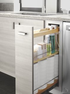 Keep your cleaning supplies organized and easily accessbile in a pull-out cabinet. Shown here: the Weston kitchen in Persian Gray from Martha Stewart Living™, available exclusively from The Home Depot.