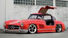 Slammed Mercedes 300 SL I usually don't like custom luxury cars, but I would take this in a heart beat.