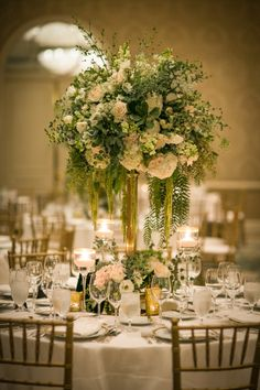 Glam tall floral centerpiece: http://www.stylemepretty.com/california-weddings/los-angeles/2015/12/21/classic-beverly-hills-ballroom-wedding/ | Photography: Michael Segal - http://michaelsegalweddings.com/