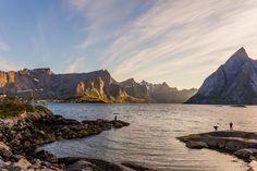 Judith Duddle // Fishermen enjoying the midnight sun in Hamnøy in the Lofoten Islands, off the coast of Norway.