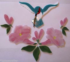Hummingbird with flowers precut stained glass mosaic art kit.  Many designs selling on ebay.