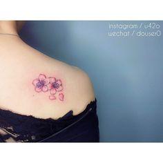 shoulder blade cherry blossom tattoo