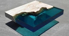Alexandre Chapelin of LA TABLE has debuted his latest water table, HAMILTON 23. Made of resin, the piece captures the beauty of the Caribbean Sea.