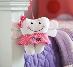 Tooth Fairy Hanging Pillow. Hangs on the Bedpost, Doorknob or anywhere you want. You can also hold it or place it anywhere. What a great Tooth Fairy Pillow, little girls will love it. I'm not sure if they gave a boy version or not.