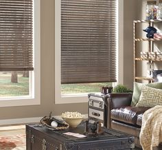 Wood blinds like Hunter Douglas Parkland™ wood blinds have been an American design element since the 18th century.  Their timeless design directs the sun, invites a gentle breeze, and the rich hardwood slats add warmth to an interior.  ♦ Hunter Douglas window treatments #LivingRoom