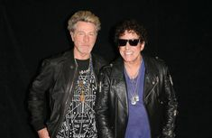 Bassist Ross Valory (L) and guitarist Neal Schon of Journey attend a memorabilia case dedication for Journey at the Hard Rock Hotel & Casino on May 3, 2017 in Las Vegas, Nevada.