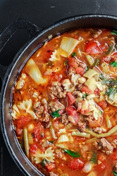 Italian Sausage Minestrone Recipe. The perfect weeknight meal! With chickpeas, artichoke hearts, green beans, fresh herbs like parsley and basil, and more! From The Mediterranean Dish