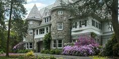 This house is so beautiful, I love the castle turrets in the front.