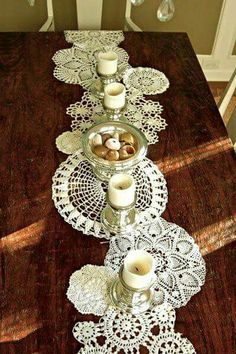 Beautiful way for a Bride to display family heirloom linens. Would be a lovely surprise Bridal shower gift from a women's sewing circle. Each doily could be labeled with a little sticker stating who it is from and good wishes for the newlyweds to be.