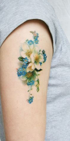 vintage flower tattoo on arm
