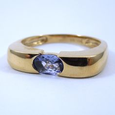 Oval Cut Tanzanite Ring. Set in 14K Yellow Gold. $300