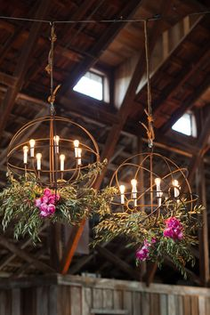 globe chandeliers with flower and candles