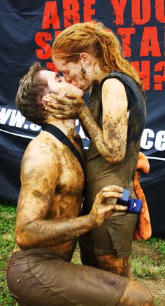 Love in the Mud...so sweet! Ne'er would expect a proposal after a race!