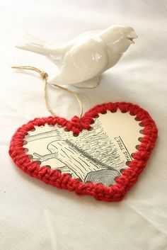 card and crochet heart. Could do this with anything. Just need to punch holes around the edges.