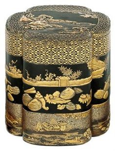 A Three-Tiered Jubako [Food Containter]   Edo Period (17th century)   Decorated in gold and silver hiramaki-e, takamaki-e and nashiji on a black ground, the top with a pagoda in a rocky moonlit landscape within a kidney-shaped panel bordered by shippo-hanabishi, the other tiers each with a different design of shells, figures in a rural landscape, and plants behind a brushwork fence, red lacquer interior  20cm. high