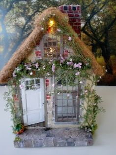Pic 1 of 3 Cottage Dollhouse inspirations. faux brick, moss, light in attic peak, create a climbing vine with miniature flower strands