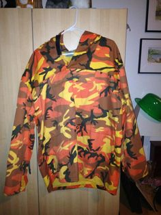 Orange camouflage outdoor hoodie - M in MissEsas Garage Sale in Warrenville , IL for $10. Mens size M
