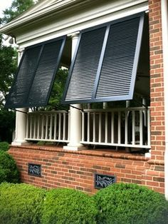 Elite Bahama Exterior Shutters - traditional - porch - charlotte - by Elite Shutters & Blinds, Inc.