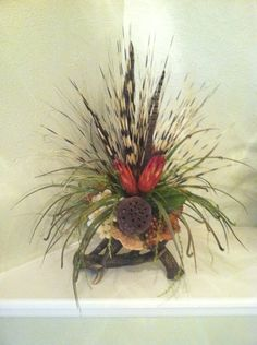Double faux deer antler arrangement. Love the two tone zebra grass and natural pods & feathers. www.greatwoodfloraldesigns.com