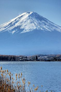 Magnificent Mt Fuji, Japan--I so longed to see it and all of a sudden, there it was in all it's glory.  Took long slow boat ride across the lake.