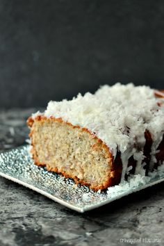 Banana Coconut Sweet Bread with Coconut Glaze ~ this bread is incredibly easy to make. It uses coconut in each element to really give it a tropical twist.