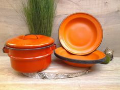 Hey, I found this really awesome Etsy listing at https://www.etsy.com/listing/463802949/vintage-enamelware-dishes-orange