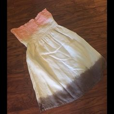 Juicy Couture Ombré  Dress or Top This is a cute little tie dye like dress or top could be worn as either made in USA by Juicy Couture. Top portion is smocked and is coral like pink bottom is gray in color as pictured. Measures 24 inches in length as u can see by photo it strikes me about 3 inches above my knee I am 5'5. Size small. I am a medium and it also fits me I'm 36 in chest as u can see top portion is stretchy. Could also be worn as bathing suit cover up. Juicy Couture Tops