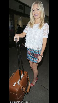 Mollie King with her Aspinal of London luggage