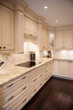 white-kitchen design Giallo Ornamental granite countertops white cabinets dark wood flooring