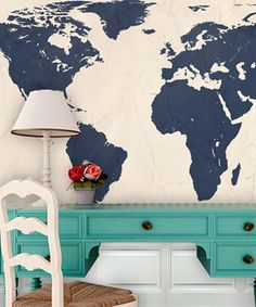 World Traveler- i like the desk in front of the map wall.