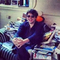 he looks so proud of his comic book collection ^-^