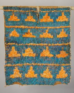 Feathered Tunic    Date:      7th–10th century  Geography:      Peru  Culture:      Wari  Medium:      Cotton, feathers