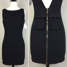 """Black open back bow dress In great condition. Low v back detail with bow. Waist 25.5"""". Dress length 30"""" ASOS Dresses"""