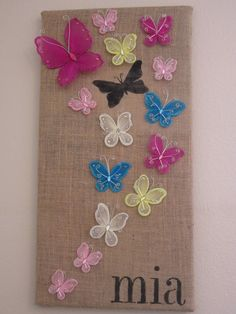 Stenciled Butterfly Wall Art - I actually like the stenciled black butterfly ... I'm thinking of doing a stamped scene on burlap mounted on canvas, using lighter colors for the butterflies and/or flowers. Pinning this one so I can remember my idea. :)