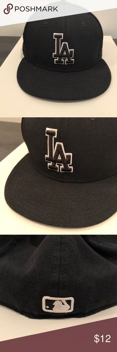 Black LA Dodgers Baseball Hat New Era Men's 7.5 Authentic New Era 59 Fifty Black LA Dodgers Baseball hat. My husband cut his hair and now this is huge on him. It's a size 7 1/2/ 59.6 cm. In great condition. New Era Accessories Hats
