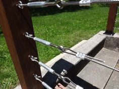 Closeup of the Yard Side Cable Railing's Stainless Steel Lag Screw Eyes and Turnbuckles Wire Deck Railing, Front Porch Railings, Cable Railing, Porch Awning, Glass Railing, Front Fence, Cable Fencing, Diy Wood Stain, Diy Garden Fence