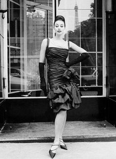 1959 Christine Tidmarsh in ruched, draped and flounced cocktail dress by Yves Saint Laurent for Dior, photo by Willy Maywald, Paris