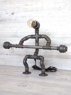 New Pictures Industrial Lamps robot Suggestions If you've got the activity, we have now the classic manufacturing table lamp. Task lighting illuminates a room. Pipe Lighting, Mason Jar Lighting, Task Lighting, Industrial Wall Lights, Industrial Pipe, Pipe Table, Table Lamp, Steampunk Desk, Halloween Wood Crafts