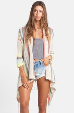 Junior Women's Billabong 'Beach Rambler' Stripe Cardigan, Size Large - Beige (882800144517) Bright serape stripes add festive color to an oversized knit cardigan finished with an asymmetrical hem and fun fringe. Color(s): blue bird, oatmeal heather. Brand: BILLABONG. Style Name: Billabong 'Beach Rambler' Stripe Cardigan (Juniors). Style Number: 1062456.