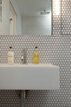 good idea to have detailed tiling near the sink - to avoid grouting lines around shower where tends to yellow...