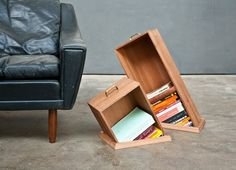 Hole in the floor bookcases by Raw Edges.