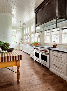 Floor to ceiling backsplash. Kitchen with floor to ceiling backsplash. Floor to ceiling kitchen backsplash. Kitchen floor to ceiling backsplash tiles, zinc hood and portable kitchen island. Wade Weissmann Architecture.