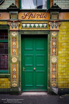 PRETTY GREEN DOOR WITH GOLD TRIM in MANCHESTER, ENGLAND