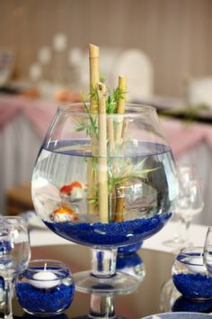 Fish bowl table centrepiece at a wedding reception