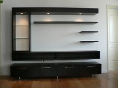 Corner TV unit designed to fit in the corner of a room with a large open storage .Corner TV unit designed to fit in the corner of a room with a large open storage . Tv Cabinet Design, Tv Wall Design, Pop Design, Design Ideas, Living Room Tv Unit Designs, Wall Unit Designs, Tv Unit Decor, Tv Wall Decor, Tv Unit Furniture Design