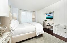 Chango & Co.: Master bedroom from another view. 20 feet of custom floor to ceiling built ins with ...