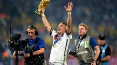 Bastian Schweinsteiger of Germany holds up the World Cup trophy