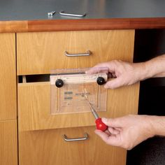 Rockler Drawer Pull JIG IT® Template and Center Punch - Creates perfectly aligned drawer pulls and knobs every time.
